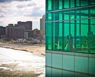 Couple in corner of Atlantic Room with beach background 320x260 - Events